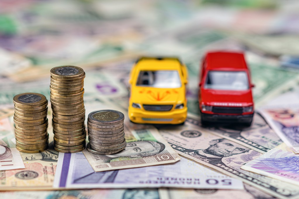 car-and-money-concept-selective-focus-image-with-shallow-depth-of-field-cash-saving-coin-car-money_t20_ax9X4E